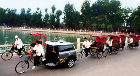 taxi 585x319 Improvements of Beijing Transport